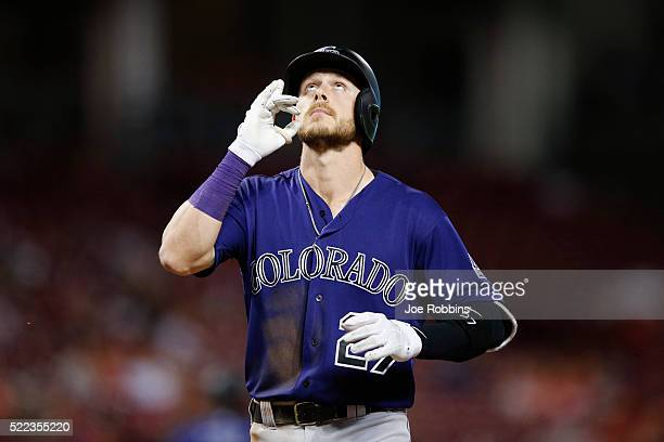 Trevor Story of the Colorado Rockies reacts after hitting a solo home run against the Cincinnati Reds in the eighth inning of the game at Great...