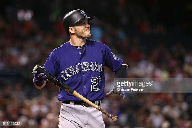 Trevor Story of the Colorado Rockies reacts to a strike out against the Arizona Diamondbacks during the sixth inning of the MLB game at Chase Field...