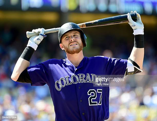 Trevor Story of the Colorado Rockies reacts to his called strikeout during the eighth inning against the Los Angeles Dodgers at Dodger Stadium on...
