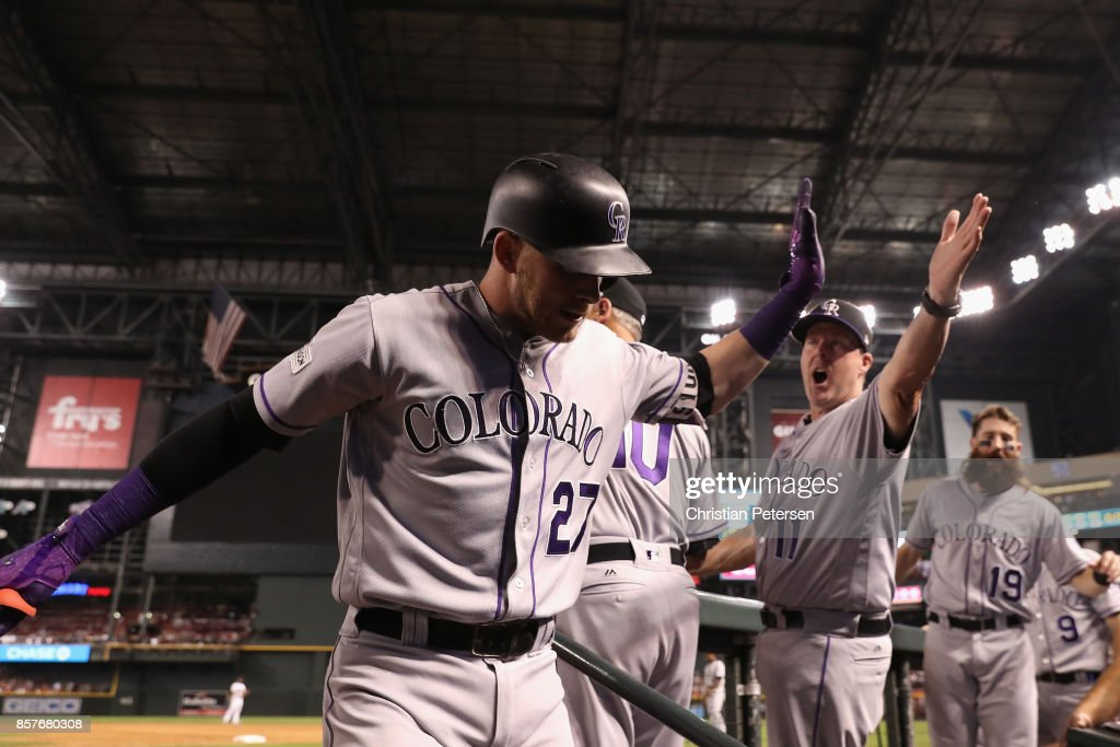 Trevor Story #27 of the Colorado Rockies reacts with bench coach Mike Redmond #11 after hitting a solo home run during the top of the eighth inning of the National League Wild Card game against the Arizona Diamondbacks at Chase Field on October 4, 2017 in Phoenix, Arizona.