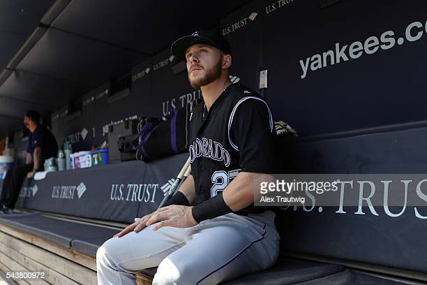 Trevor Story of the Colorado Rockies sits in the dugout prior to the game against the New York Yankees at Yankee Stadium on Wednesday June 22 2016 in...