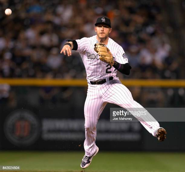 Trevor Story of the Colorado Rockies throws to first base after fielding a ground ball by AJ Pollock of the Arizona Diamondbacks in the eighth inning...