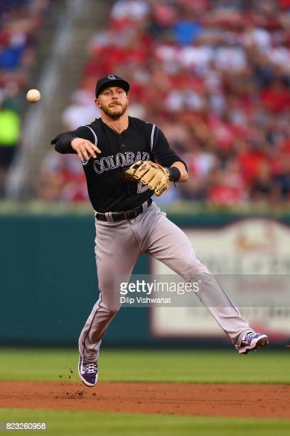 Trevor Story of the Colorado Rockies throws to first base against the St Louis Cardinals in the second inning at Busch Stadium on July 26 2017 in St...