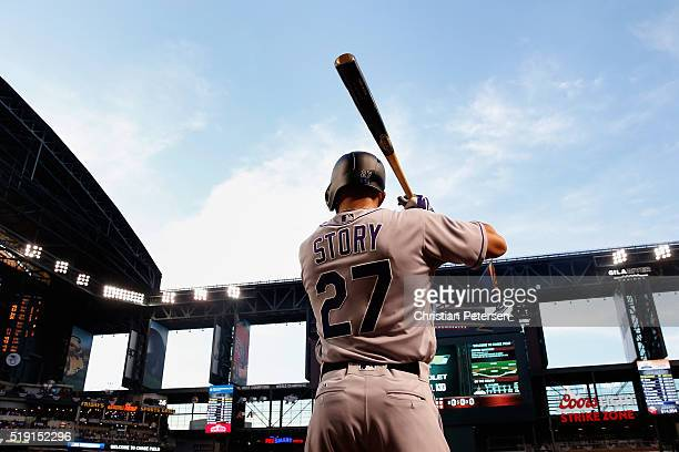 Trevor Story of the Colorado Rockies warms up on deck before the start of the MLB opening day game against the Arizona Diamondbacks at Chase Field on...