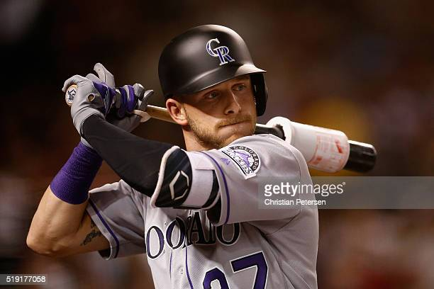 Trevor Story of the Colorado Rockies warms up on deck during the third inning of the MLB opening day game against the Arizona Diamondbacks at Chase...