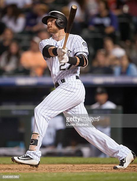 Trevor Story of the Colorado Rockies watches the flight of a seventh inning 2run home run against the Cincinnati Reds at Coors Field on June 2 2016...