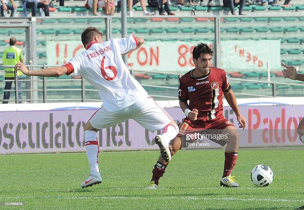 Trevor Trevisan (L) of Padova competes with Nicolas Viola of Reggina during the Serie B match between Calcio Padova and Reggina Calcio at Stadio Euganeo on September 22, 2012 in Padova, Italy.