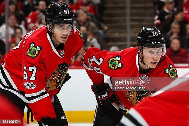 Trevor van Riemsdyk and Dennis Rasmussen of the Chicago Blackhawks wait for the faceoff against the Carolina Hurricanes in the first period at the...