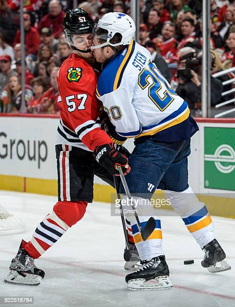 Trevor van Riemsdyk of the Chicago Blackhawks and Alexander Steen of the St Louis Blues get physical in the second period of Game Four of the Western...