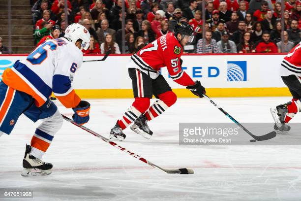 Trevor van Riemsdyk of the Chicago Blackhawks approaches the puck ahead of Joshua HoSang of the New York Islanders in the first period at the United...
