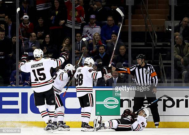 Trevor van Riemsdyk of the Chicago Blackhawks celebrates his goal with teammates Artem Anisimov and Patrick Kane in the second period against the New...