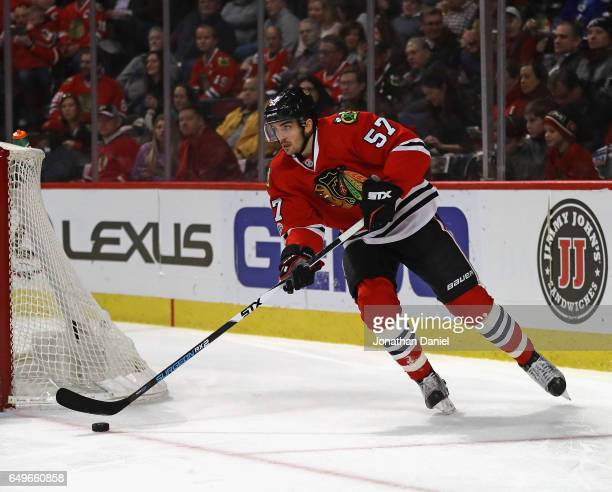 Trevor van Riemsdyk of the Chicago Blackhawks clears the puck against the New York Islanders at the United Center on March 3 2017 in Chicago Illinois...