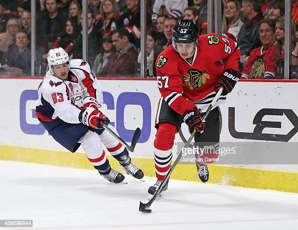 Trevor van Riemsdyk of the Chicago Blackhawks controls the puck in front of Jay Beagle of the Washington Capitals at the United Center on November 7...