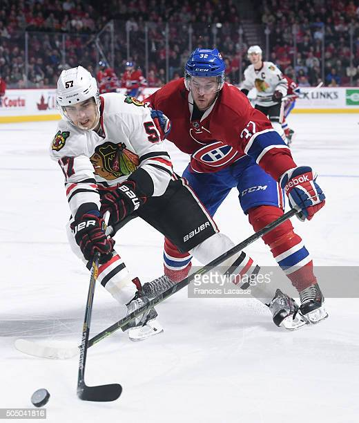 Trevor Van Riemsdyk of the Chicago Blackhawks controls the puck against Brian Flynn of the Montreal Canadiens in the NHL game at the Bell Centre on...