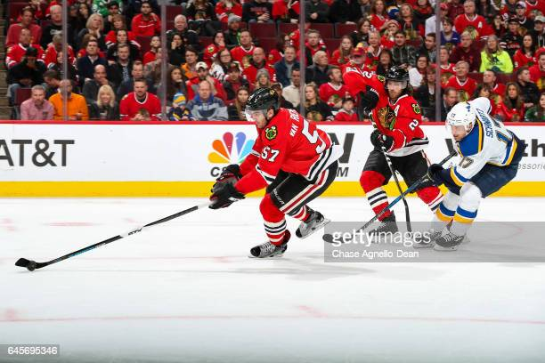 Trevor van Riemsdyk of the Chicago Blackhawks grabs the puck ahead of Duncan Keith and Jaden Schwartz of the St Louis Blues in the third period at...