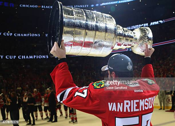 Trevor van Riemsdyk of the Chicago Blackhawks hoists the Stanley Cup in celebration after his team defeated the Tampa Bay Lightning 20 in Game Six of...