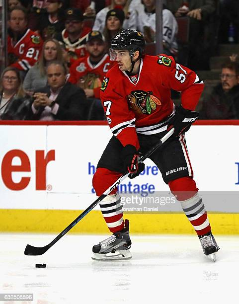Trevor van Riemsdyk of the Chicago Blackhawks looks to pass against the Vancouver Canucks at the United Center on January 22 2017 in Chicago Illinois...
