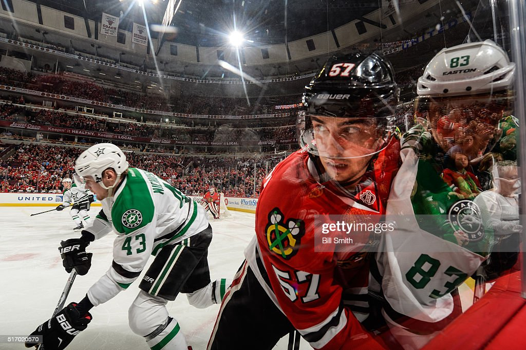 <a gi-track='captionPersonalityLinkClicked' href=/galleries/search?phrase=Trevor+van+Riemsdyk&family=editorial&specificpeople=11505180 ng-click='$event.stopPropagation()'>Trevor van Riemsdyk</a> #57 of the Chicago Blackhawks pushes <a gi-track='captionPersonalityLinkClicked' href=/galleries/search?phrase=Ales+Hemsky&family=editorial&specificpeople=202828 ng-click='$event.stopPropagation()'>Ales Hemsky</a> #83 of the Dallas Stars into the glass as <a gi-track='captionPersonalityLinkClicked' href=/galleries/search?phrase=Valeri+Nichushkin&family=editorial&specificpeople=8615473 ng-click='$event.stopPropagation()'>Valeri Nichushkin</a> #43 skates in the background in the second period of the NHL game at the United Center on March 22, 2016 in Chicago, Illinois.
