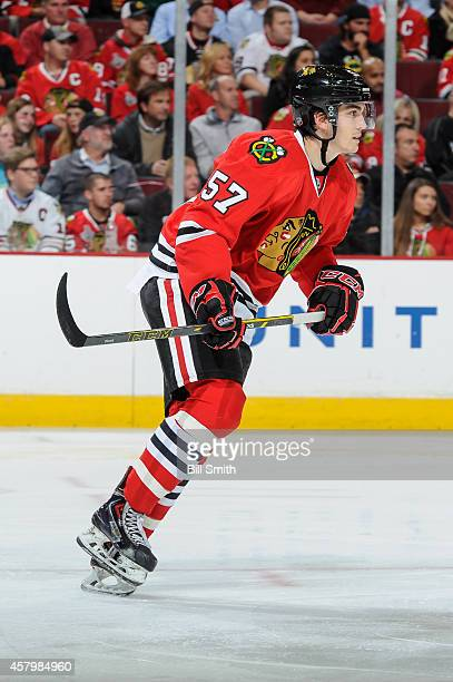 Trevor van Riemsdyk of the Chicago Blackhawks skates during the NHL game against the Calgary Flames on October 15 2014 at the United Center in...