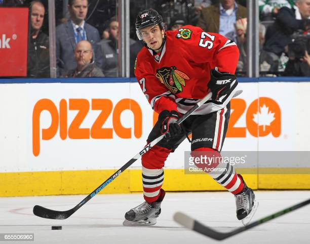 Trevor van Riemsdyk of the Chicago Blackhawks skates with the puck against the Toronto Maple Leafs during an NHL game at the Air Canada Centre on...