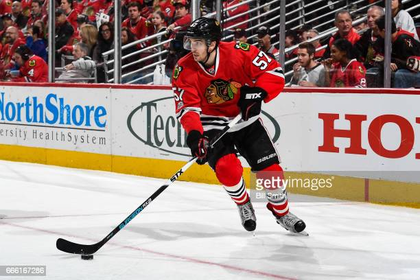 Trevor van Riemsdyk of the Chicago Blackhawks takes control of the puck in the second period against the Boston Bruins at the United Center on April...