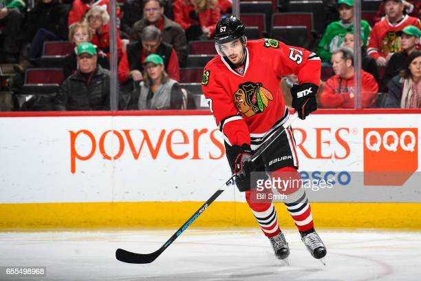 Trevor van Riemsdyk of the Chicago Blackhawks watches for the puck in the second period against the Minnesota Wild at the United Center on March 12...