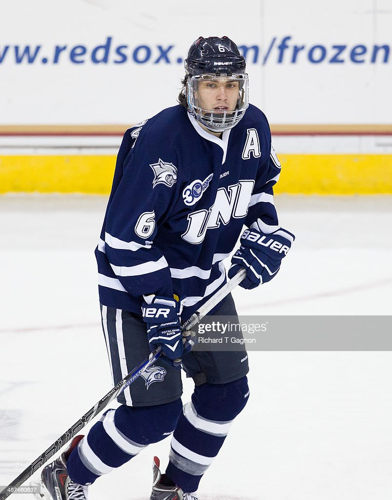 Trevor van Riemsdyk #6 of the New Hampshire Wildcats looks for a pass during NCAA hockey action against the Boston College Eagles at Kelley Rink on December 6, 2013 in Chestnut Hill, Massachusetts.