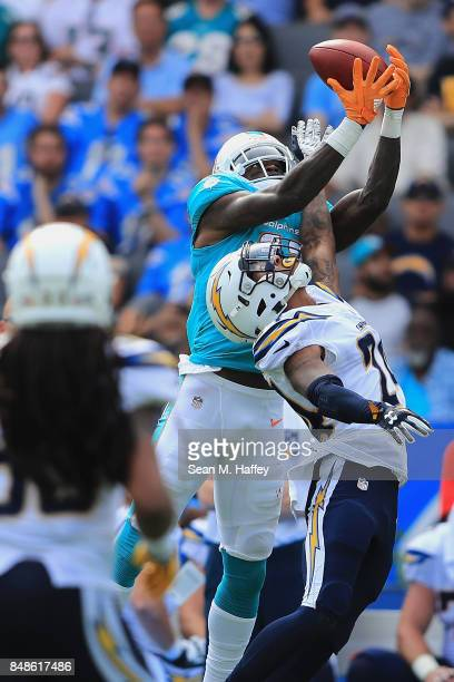 Trevor Williams of the Los Angeles Chargers breaks up a pass intended for DeVante Parker of the Miami Dolphins during the second half of a game at...