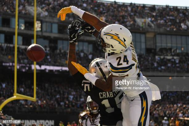 Trevor Williams of the Los Angeles Chargers defends a pass intended for Michael Crabtree of the Oakland Raiders during their NFL game at...