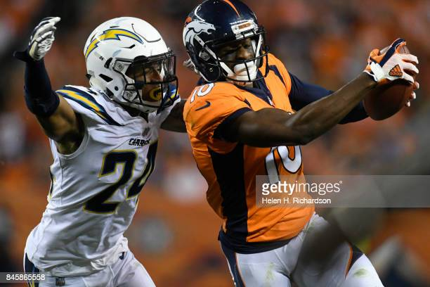 Trevor Williams of the Los Angeles Chargers drives Emmanuel Sanders of the Denver Broncos out of bounds making a 20yard run for a first down during...