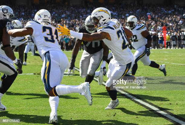 Trevor Williams of the Los Angeles Chargers returns an interception against the Oakland Raiders during an NFL football game at OaklandAlameda County...