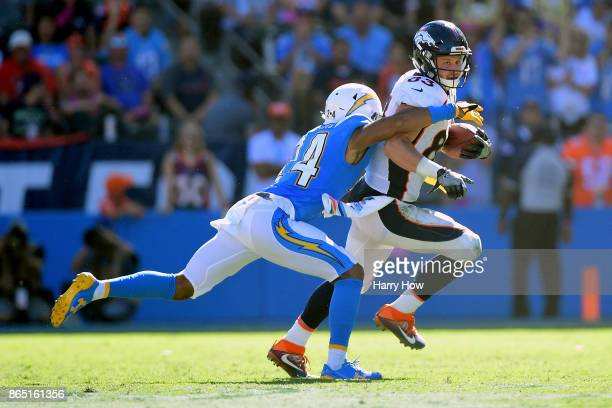 Trevor Williams of the Los Angeles Chargers tackles AJ Derby of the Denver Broncos at the StubHub Center on October 22 2017 in Carson California