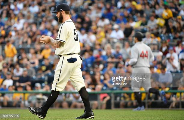 Trevor Williams of the Pittsburgh Pirates reacts after allowing a walk to Anthony Rizzo of the Chicago Cubs in the first inning during the game at...