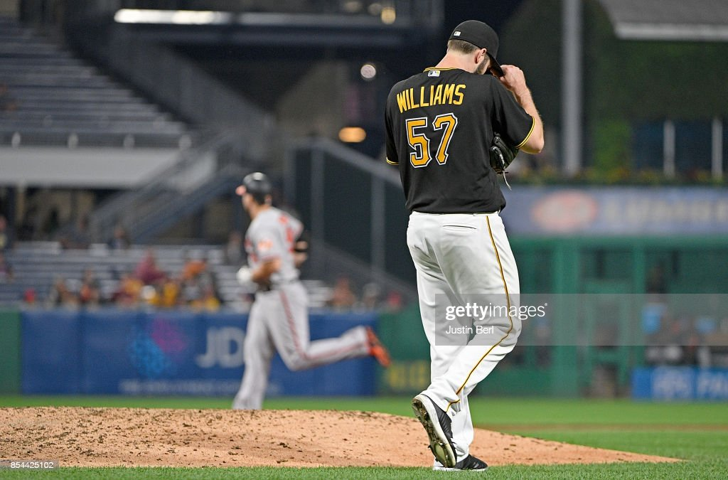 Trevor Williams #57 of the Pittsburgh Pirates reacts as Chris Davis #19 of the Baltimore Orioles rounds the bases after hitting a solo home run in the sixth inning during the game at PNC Park on September 26, 2017 in Pittsburgh, Pennsylvania.