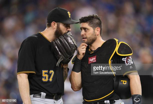 Trevor Williams of the Pittsburgh Pirates talks to Francisco Cervelli on the mound in the fifth inning during MLB game action against the Toronto...