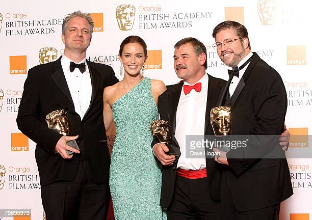 Trevor Wood Ben Morris and Bill Westenhofer pose in the Awards Room with the award for Special Visual Effects for 'The Golden Compass' presented by...
