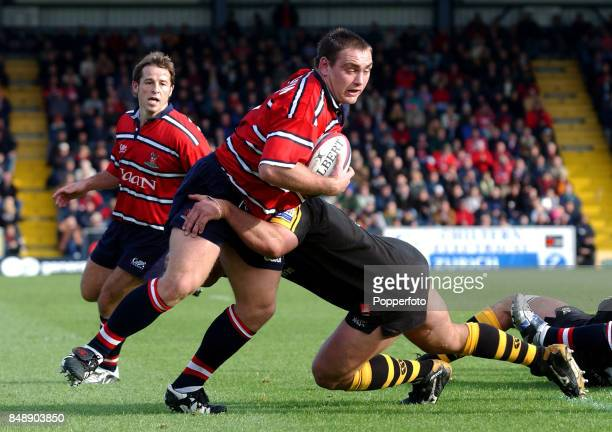 Trevor Woodman of Gloucester is tackled by Craig Dowd of London Wasps during the Zurich Premiership match between Wasps and Gloucester at Adams Park...