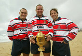 Trevor Woodman Phil Vickery and Andy Gomarsall of Gloucester hold the William Webb Ellis Trophy wearing their Zurich Premiership shirts pose on...