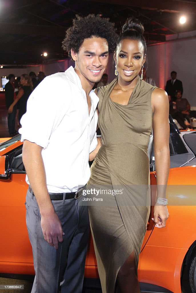 DJ Trey 'ACE' Smith and <a gi-track='captionPersonalityLinkClicked' href=/galleries/search?phrase=Kelly+Rowland&family=editorial&specificpeople=201760 ng-click='$event.stopPropagation()'>Kelly Rowland</a> with the all-new F-TYPE at the Jaguar ang GiltCityeventto celebratethe#MyTurnToJag social media contest at Soho Studios on July 15, 2013 in Miami, Florida.