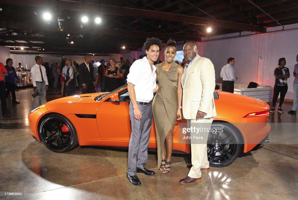 DJ Trey 'ACE' Smith, Kelly Rowland and Ray Warren with the all-new F-TYPE at the Jaguar ang GiltCityeventto celebratethe#MyTurnToJag social media contest at Soho Studios on July 15, 2013 in Miami, Florida.
