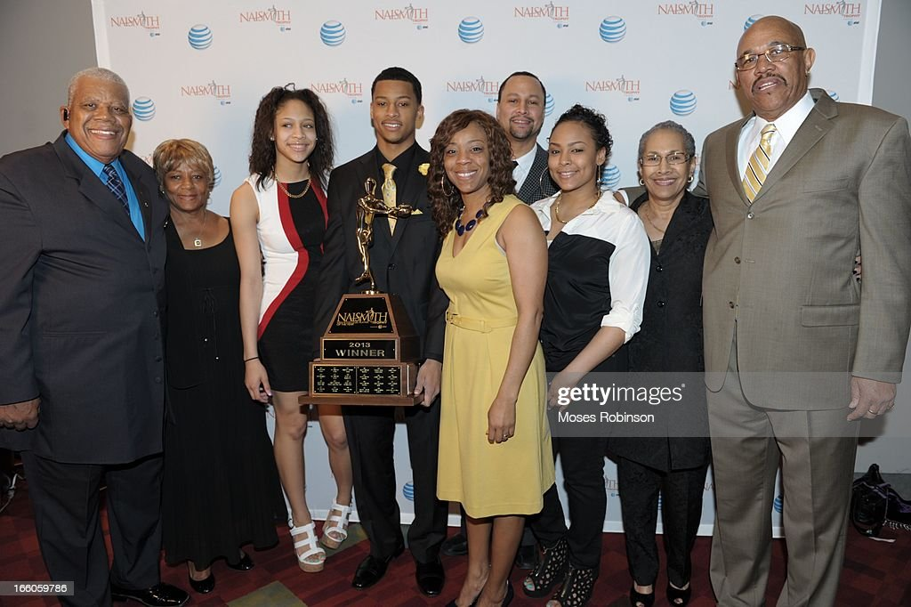 Trey Burke and his family pose with the 2013 Naismith Trophy at the NABC Guardians of the Game Awarding of the Naismith Trophy at Georgia World Congress Center on April 7, 2013 in Atlanta, Georgia.
