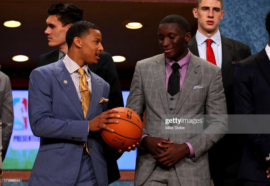 Trey Burke of Michigan, drafted #9 overal by the Minnesota Timberwolves (later traded to the Utah Jazz) tals with Victor Oladipo of Indiana, drafted #2 overall in the first round by the Orlando Magic, prior to the start if the first round during the 2013 NBA Draft at Barclays Center on June 27, 2013 in in the Brooklyn Bourough of New York City.