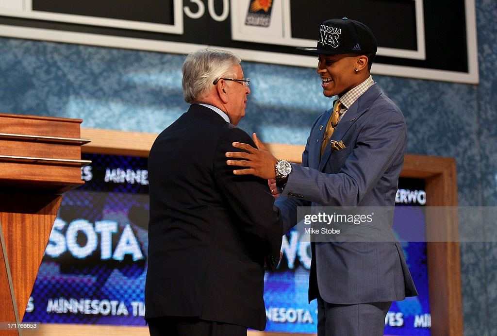 Trey Burke (R) of Michigan greets NBA Commissioner David Stern after Burke was drafted #9 overall in the first round by the Minnesota Timberwolves during the 2013 NBA Draft at Barclays Center on June 27, 2013 in in the Brooklyn Borough of New York City. Burke was traded later in the evening to the Utah Jazz.