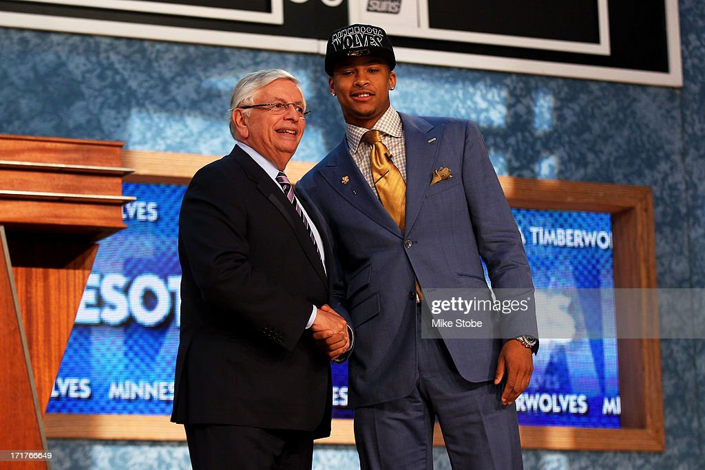 Trey Burke (R) of Michigan poses for a photo with NBA Commissioner David Stern after Burke was drafted #9 overall in the first round by the Minnesota Timberwolves during the 2013 NBA Draft at Barclays Center on June 27, 2013 in in the Brooklyn Borough of New York City. Burke was traded later in the evening to the Utah Jazz.