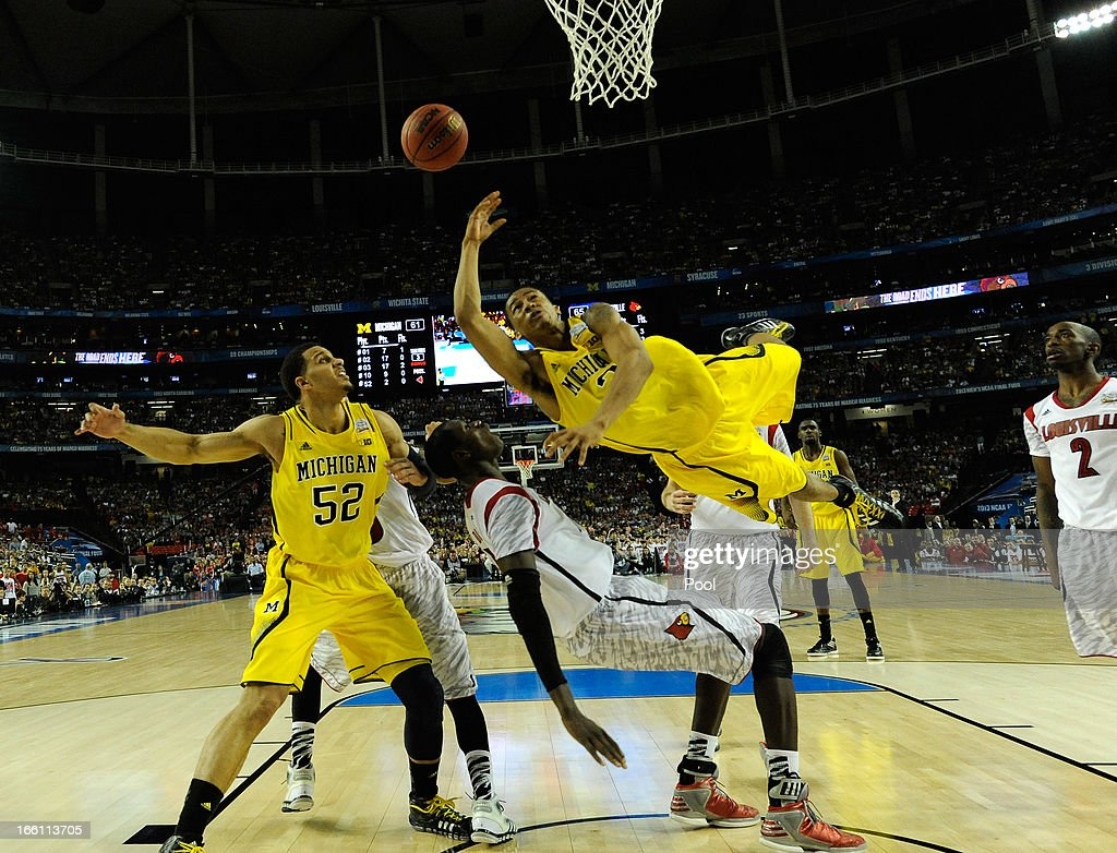 Trey Burke #3 of the Michigan Wolverines attempts a shot against Gorgui Dieng #10 of the Louisville Cardinals during the 2013 NCAA Men's Final Four Championship at the Georgia Dome on April 8, 2013 in Atlanta, Georgia.