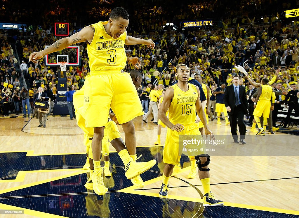 Trey Burke #3 of the Michigan Wolverines celebrates a 58-57 win over the Michigan State Spartans with Jon Horford #15 at Crisler Center on March 3, 2013 in Ann Arbor, Michigan.