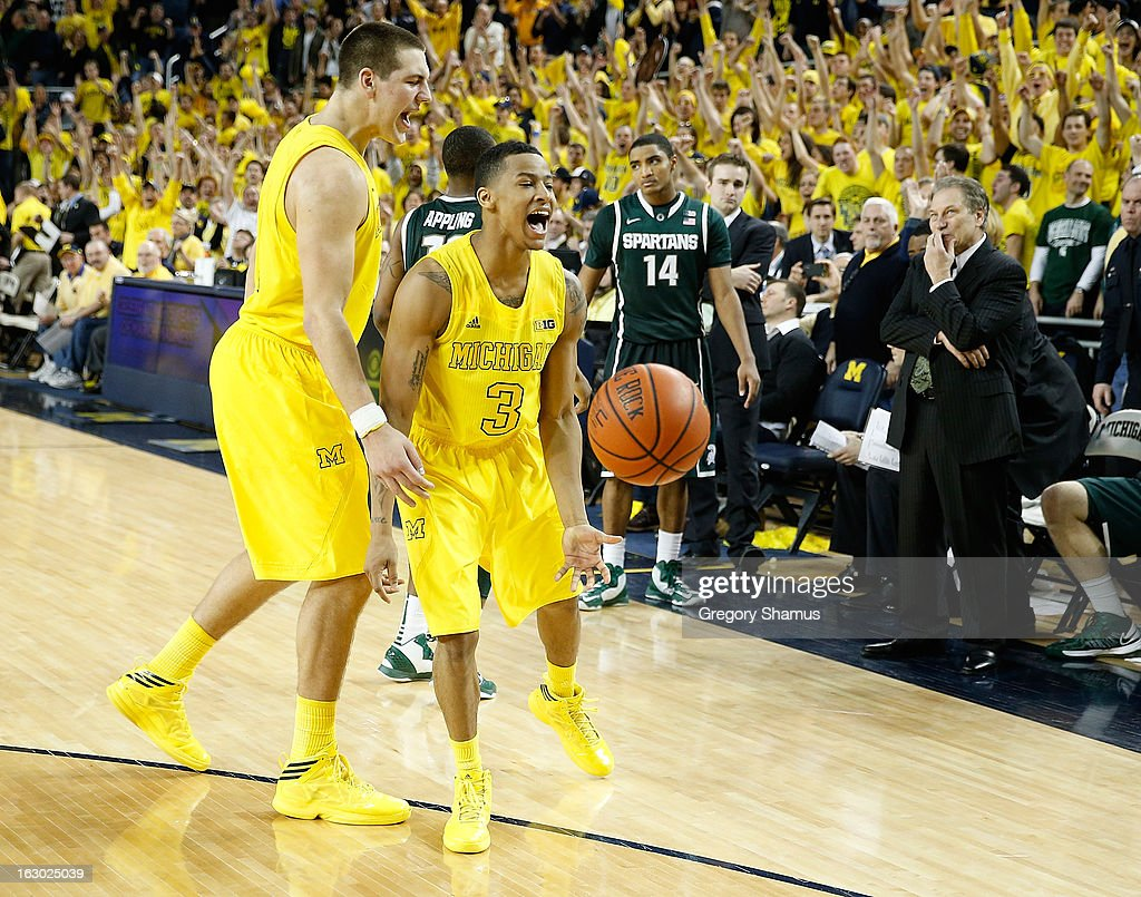 Trey Burke #3 of the Michigan Wolverines celebrates a 58-57 win over the Michigan State Spartans with Mitch McGary #4 at Crisler Center on March 3, 2013 in Ann Arbor, Michigan.