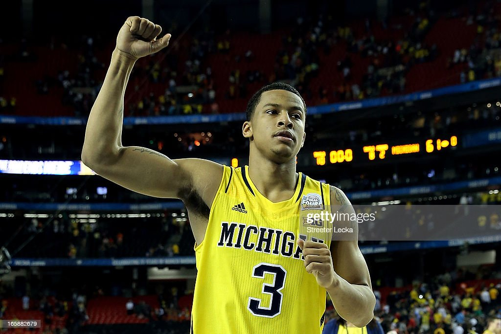 Trey Burke #3 of the Michigan Wolverines celebrates the Wolverines 61-56 victory against the Syracuse Orange during the 2013 NCAA Men's Final Four Semifinal at the Georgia Dome on April 6, 2013 in Atlanta, Georgia.