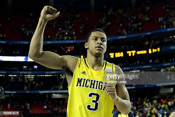 Trey Burke of the Michigan Wolverines celebrates the Wolverines 6156 victory against the Syracuse Orange during the 2013 NCAA Men's Final Four...