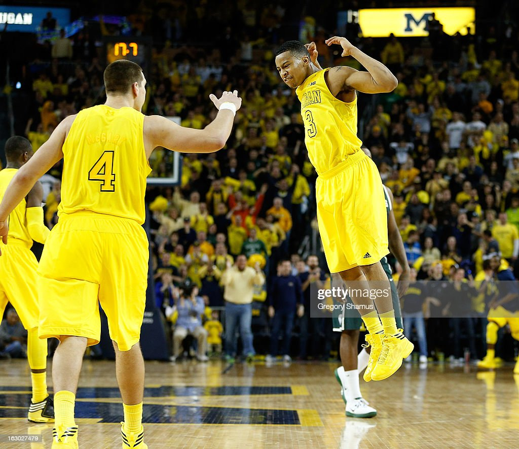 Trey Burke #3 of the Michigan Wolverines celebrates with Mitch McGary #4 late in the second half while playing the Michigan State Spartans at Crisler Center on March 3, 2013 in Ann Arbor, Michigan. Michigan won the game 58-57.